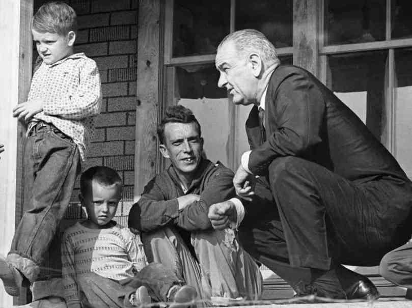 LBJ with the Fletcher family of Inez, KY.
