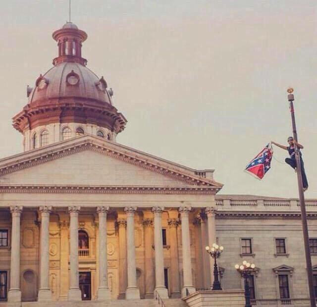 Activist Bree Newsome removing the Confederate flag outside the SC State Capitol.